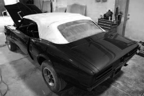 Some people feel a bit intimidated when it comes to replacing their convertible top, what with all the cables and braces and mechanisms. Take, for instance, this 1967 Firebird. After 40 years, the vinyl top material had become wrinkled and dingy, and the plastic rear window had become yellowed and hazy.