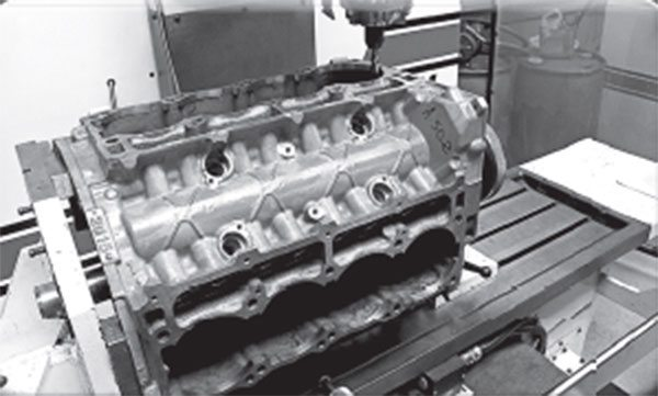 Four decades later, Tom Hoover fi nally got his wish for a raised cam tunnel. As with every 5.7-, 6.1-, and 6.4-liter Gen-III Hemi, the prominent feature is displayed in the valley of this 6.1 block, which is undergoing surgery to become a 440.