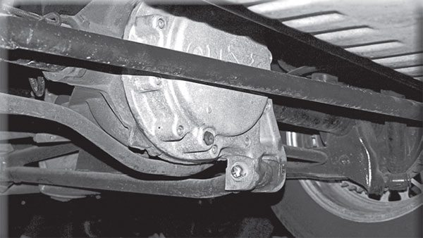 This unique ladder bar rear suspension forced installation of dual inline muffl ers on the 1987 GNX. Standard Regal turbo GNs used a more restrictive single-transverse muffl er.