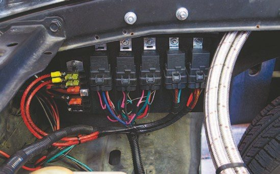 Fig. 4.9. I mounted the headlight relays to the panel. Waterproof relays are a must for an install such as this because the vehicle has no inner fenders.
