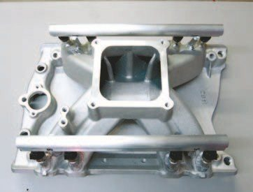 Fig. 6.6. We chose the Edelbrock Victor manifold with a 4500-series flange to mate perfectly with the throttle body. The injectors are mounted low in the runners so they have a straight shot into the intake port of the cylinder head.