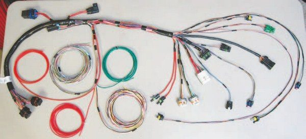 Fig. 7.29. I terminated the harness with the plugs included in the kit. I also added 14-gauge power leads (terminated with single-position Weatherpack plugs in the center) for the DIS coil packs.