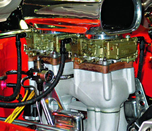 Spacers made of a composite or phenolic material can help to reduce heat-soak at the carburetor. If a spacer is used, longer carburetor mounting studs are required.