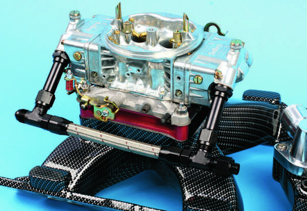 An aluminum carburetor spacer not only slightly extends the air column but also serves to dissipate heat. When a spacer is used, a gasket is required between the manifold flange and spacer as well as between the spacer and carb.