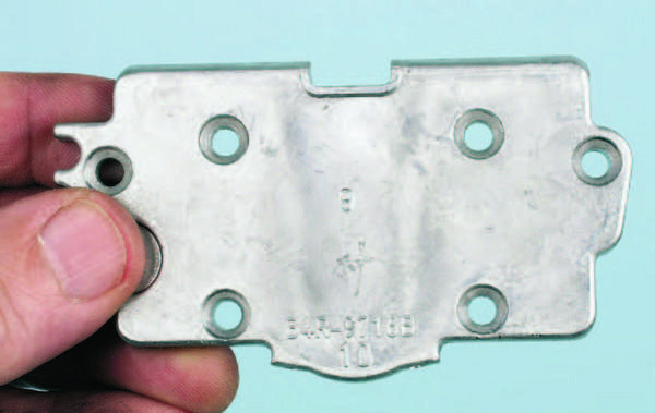 "All Holley secondary metering plates are stamped with a one- or two-digit identification number in the center area. Production numbers, which can be ignored, are stamped at the center bottom. The ""9"" in the center identifies this plate as PN 134-9; its main metering holes are .067 inch and its idle holes are .031 inch. Metering plates are available in a wide range of primary and idle circuit sizes."