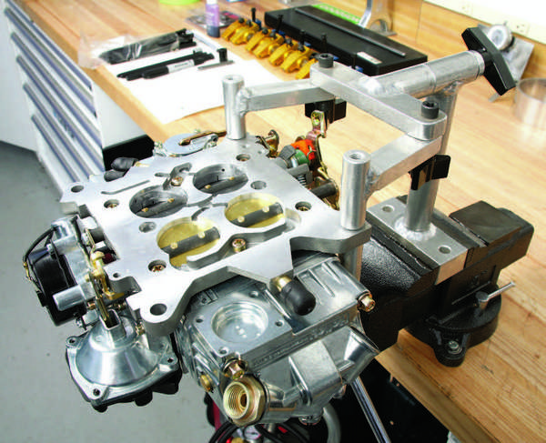 This AED fixture, with the carb positioned upside-down, is solid and sturdy. The mounting arms pivot to align with one side of any carb's baseplate.