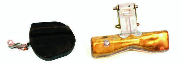 A Nitrophyl float (left) must be inspected by weighing it after it is immersed and soaked in solvent or gasoline. A brass float (right) may be weighed or immersed in water to see if bubbles are released. Or, if it was removed recently, you can shake the brass float to try to detect any fuel that may have leaked inside.