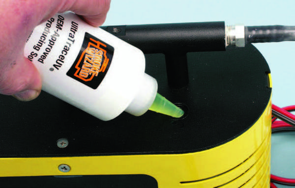 Smoke machines utilize a non-toxic and material-safe fluid, such as baby oil. The machine is connected to a 12-volt source such as the vehicle battery, along with compressed air. The fluid is gently heated and pushed into the engine at any source to check for fluid or vacuum leaks.